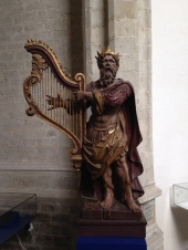 Saint (?) with harp with face.