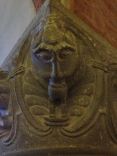 Man-eater or a man being born from the mouth. Top of a pillar.