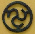 A bronze-age ornamental disc (triskel).